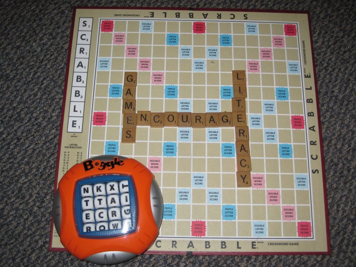 a photo of scrabble  with the tiles saying Games Encourage Literacy